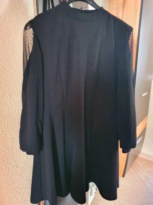 Blusa de cuello alto negro