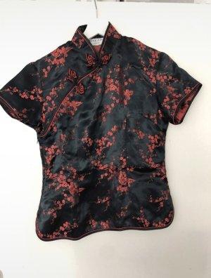 Blouse en soie noir-rouge carmin