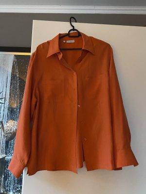 Glanzende blouse donker oranje Zijde