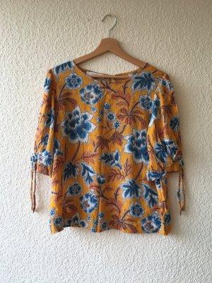 Bluse in Gelb und Blau mit großem Blumenmuster