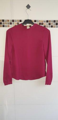 Bluse in pink hochgeschlossen