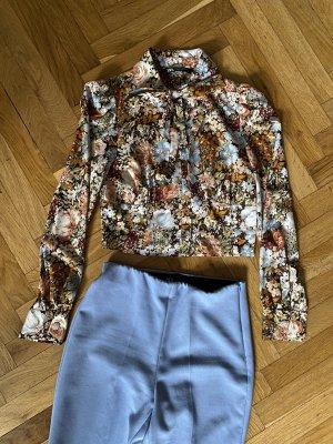 Bluse mit floralem Print von Zara