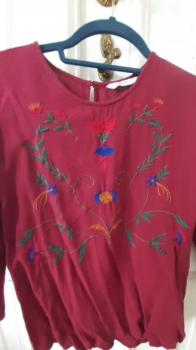 Bluse mit floralen Stickereien