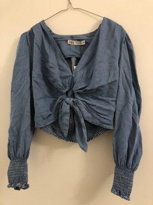 Bluse mit Knoten vorne