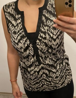 Bluse mit Muster und Knöpfen