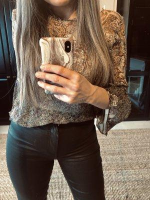 Bluse mit Muster und rückendekolte zara