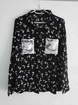 Bluse mit Pailletten Taschen und Blumen