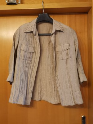 Bluse mit Schulterpolster
