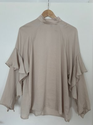 H&M Conscious Collection Blusa con volantes crema