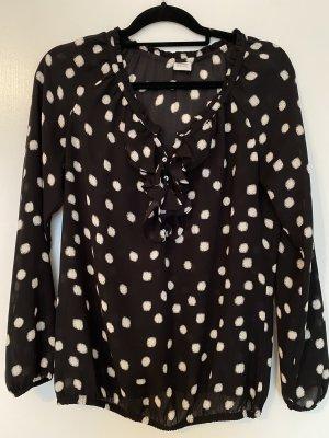 Bluse schwarz/weiß gepunktet 36