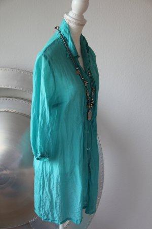Blusa larga turquesa
