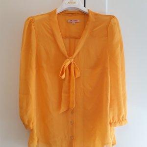 Review Blouse avec noeuds jaune-orange doré