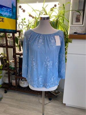 Cols de blouses bleu fluo