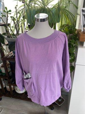 Inserción de blusa púrpura
