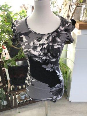 Inserción de blusa blanco-negro