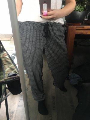 bobi pantalón de cintura baja color plata-gris