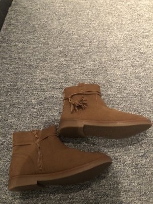 Botas de piel color bronce