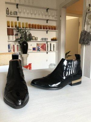 Boots Lack schwarz Gold 38