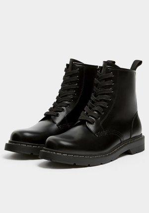 Boots Stiefel Größe 41