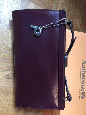 Bordeauxrote Unterarmtasche