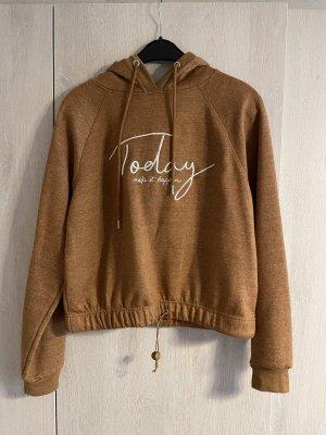 Brauner Pullover mit Aufschrift