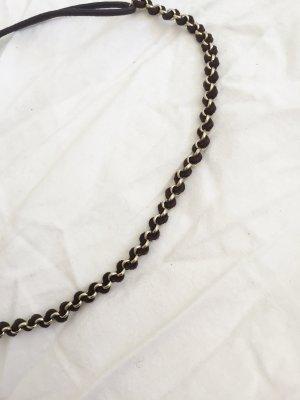 Braunes Haarband mit goldfarbenen Ringen