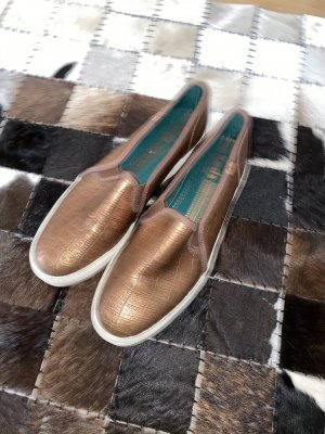 Bronzefarbende Slipper