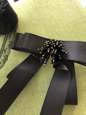 Brooch black-gold-colored