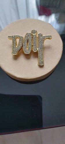Broche color oro