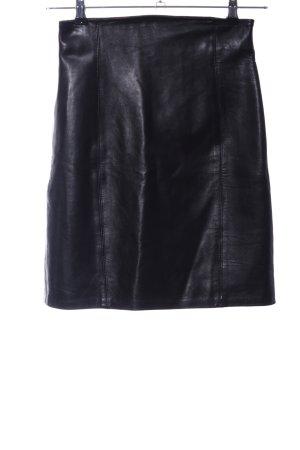 caché Falda de cuero negro look casual