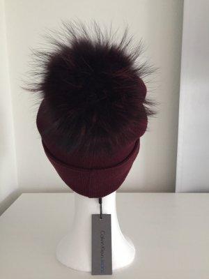 Calvin Klein Mütze mit XL Echtfellbommel