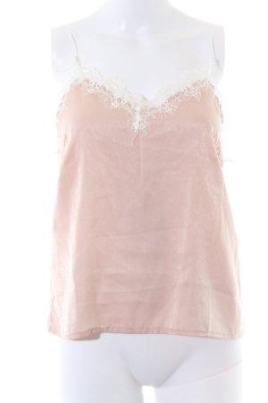 Camisola rosa empolvado look nude