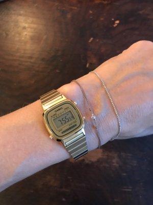 Casio Reloj digital color oro