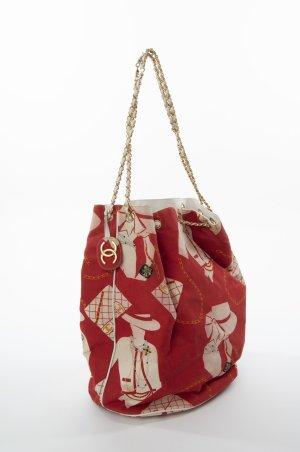 CHANEL - Bucket Bag mit graphischem Print Rot