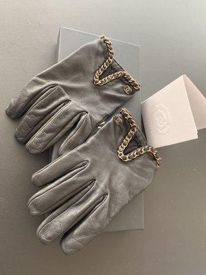 Chanel Leren handschoenen zwart-goud Leer