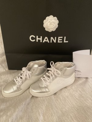 Chanel Sneaker stringata bianco-argento