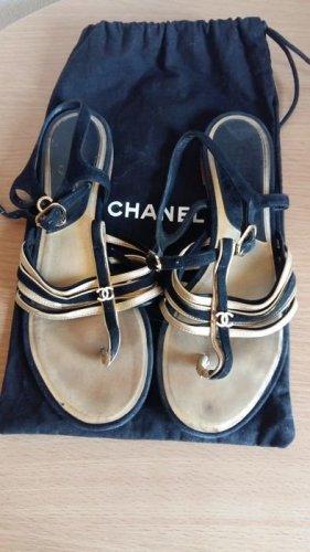 Chanel Sandalias con talón descubierto negro-color oro Cuero