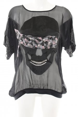 Charlotte Sparre Transparante blouse zwart prints met een thema
