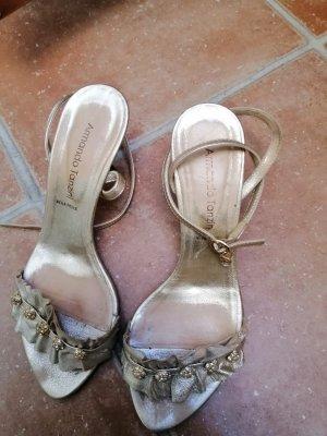 aus Italien Sandalen met bandjes en hoge hakken goud