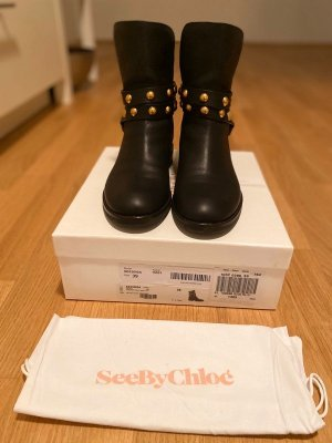 Chloé Botas de tobillo negro-color oro Cuero