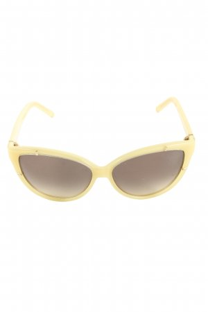 Chloé Gafas mariposa color oro look casual