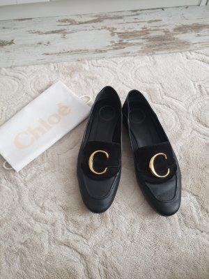 Chloé Pantoffels zwart-goud Leer