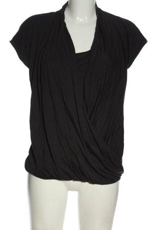 Cinque Blusa cruzada negro look casual