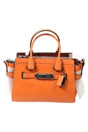 Coach Handgelenktasche in Orange aus Leder