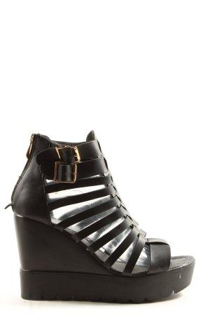 Coco Perla Sandalo con plateau nero stile casual