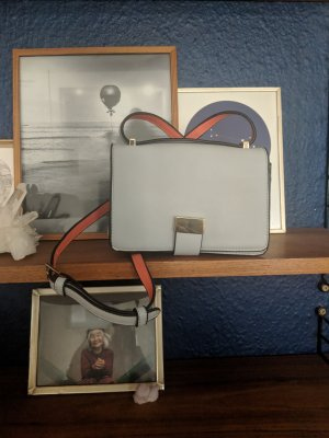 Cool grey and orange cross body bag