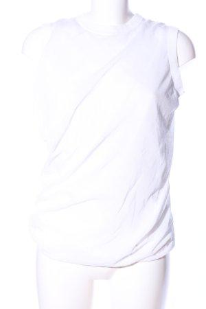 COS Top básico blanco look casual