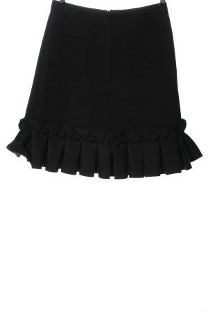 COS Rozkloszowana spódnica czarny W stylu biznesowym