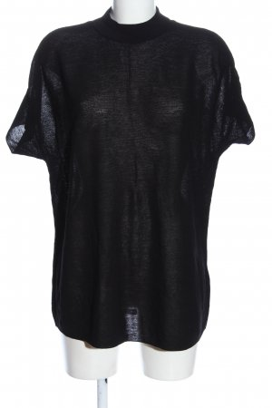 COS Jersey de manga corta negro moteado look casual