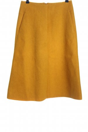 COS Jupe mi-longue orange clair style décontracté